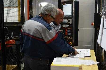 Two People Planning Laser Cutting