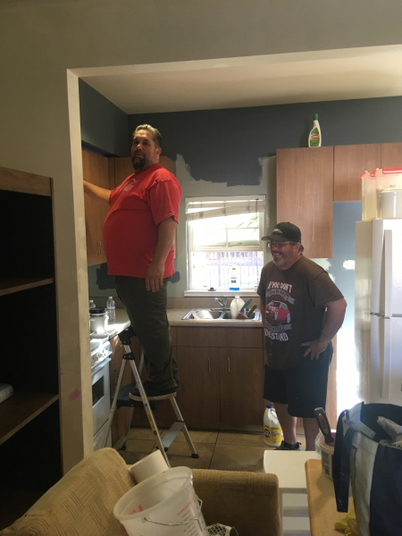 Marcelo and Dan spruce up the kitchen.
